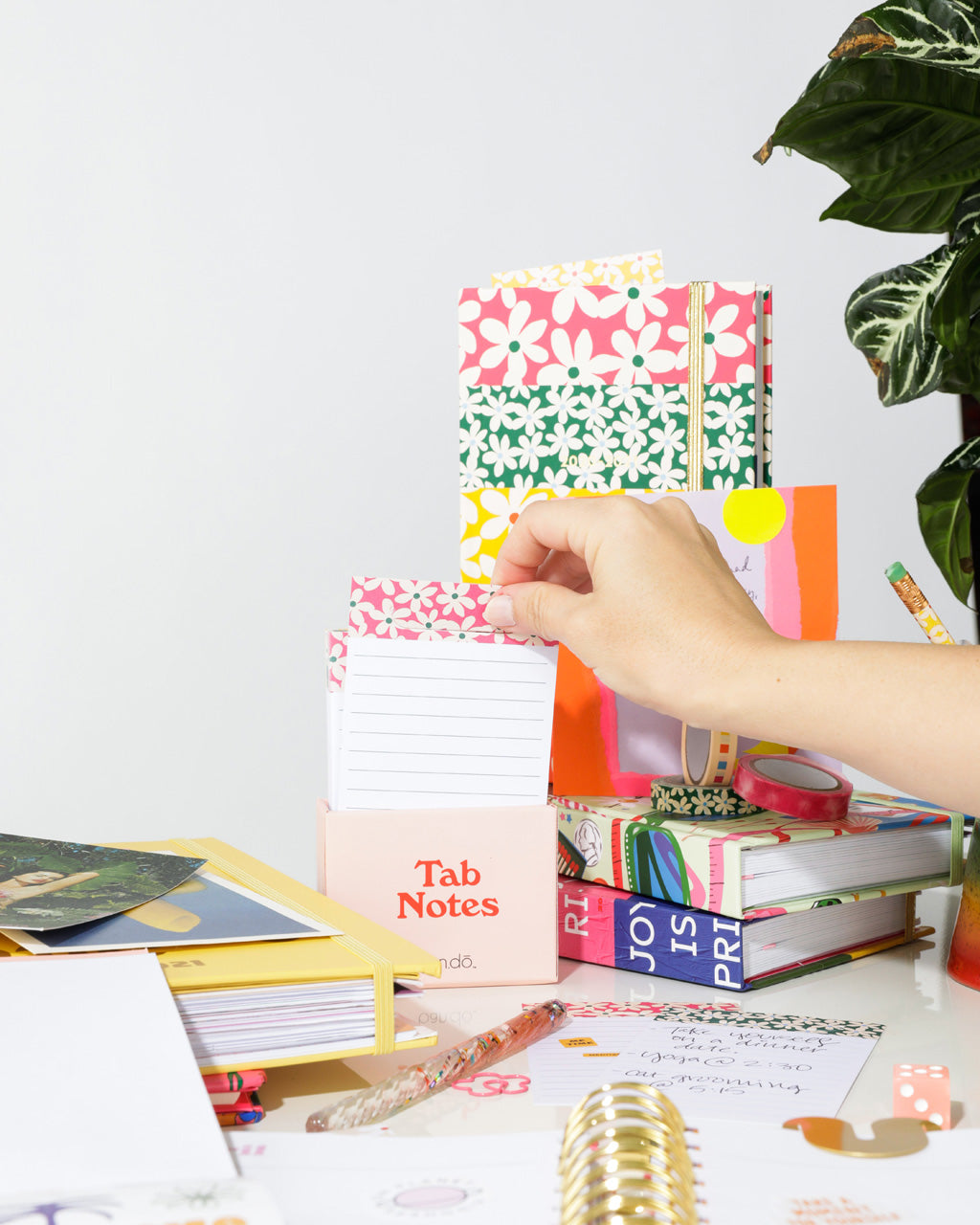 lifestyle image of tab notes shown with other bando products on a desk
