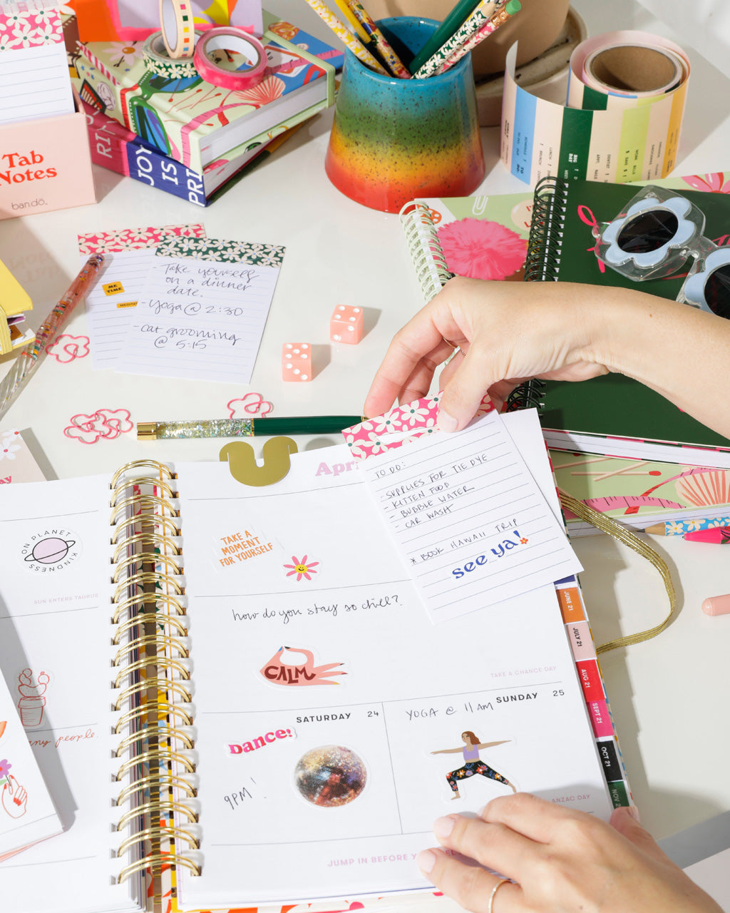 lifestyle image of tab notes being used in a bando planner, other bando products shown as well