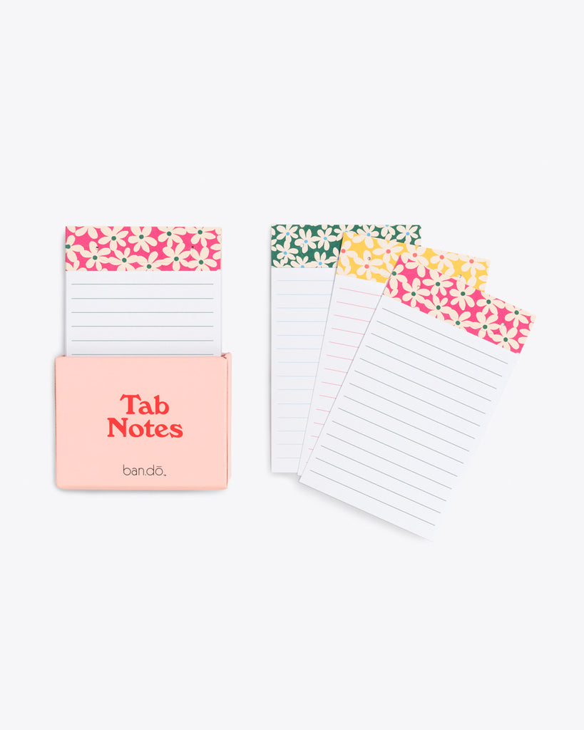 various colored daisy patterns featured on lined tab notes