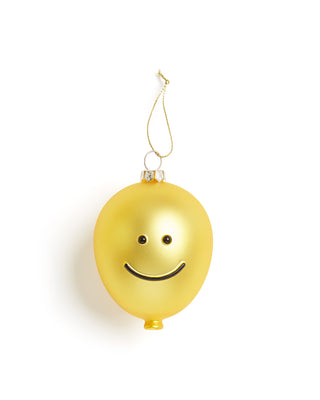Yellow glass ornament with a smiley face.