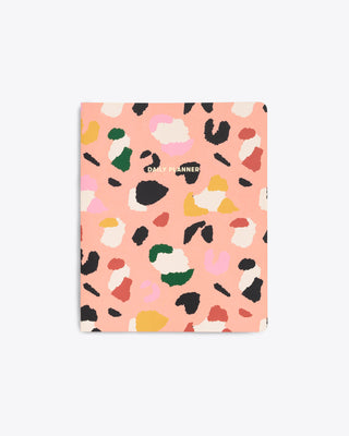 flexible cover to do planner with a multi color leopard print design