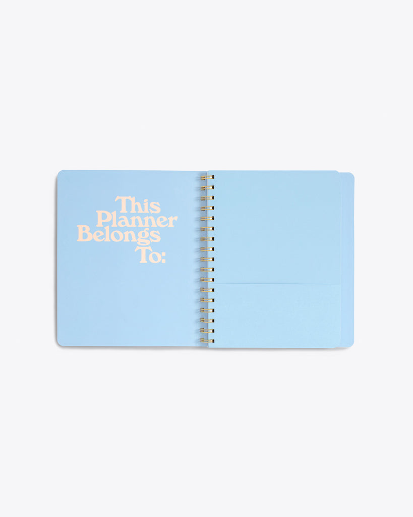 "inside cover of notebook in blue with pocket and ""This Planner Belongs To:"" text graphic"
