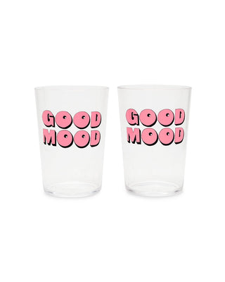 These Party On Cocktail Tumblers are clear, with 'Good Mood' printed in pink on the outside.