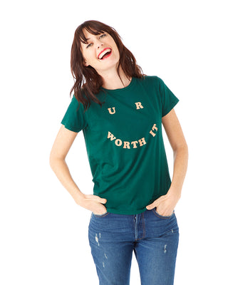 "woman wearing a dark green tee with ""U R WORTH IT"" in light peach letters"