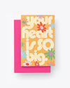 "yellow folded card with multi color floral pattern with large word graphic ""Your heart is so big"" with pink envelope"