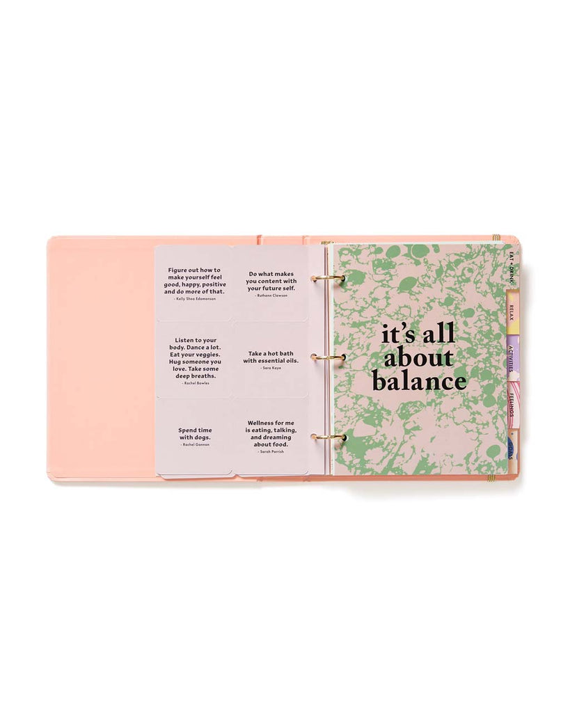 "Interior page of planner with ""It's All About Balance"" printed on a pink and green pattern"