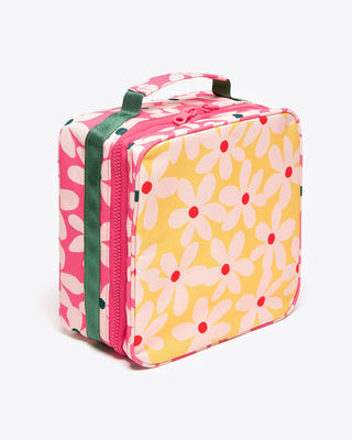 square lunch bag with a yellow and pink daisy pattern featuring green accents