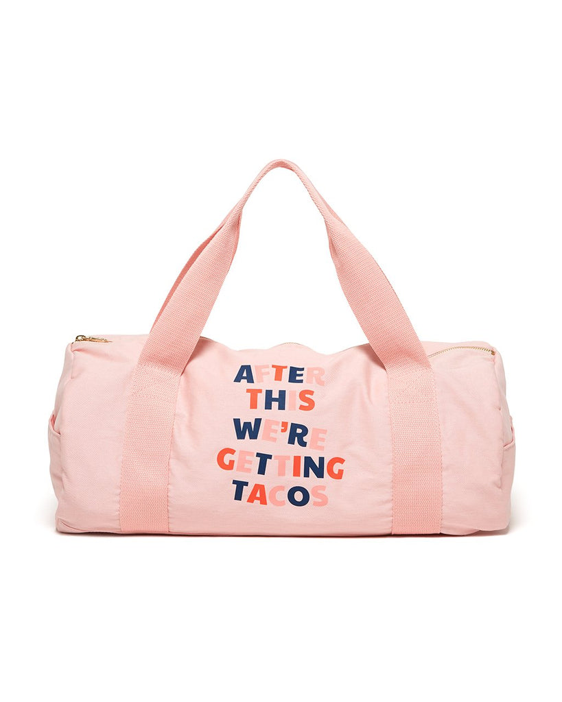 This gym bag comes in pink, with 'After This We're Getting Tacos' printed on the front.