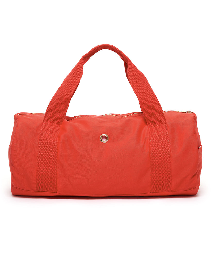 Back view of red ruffle bag with handles.