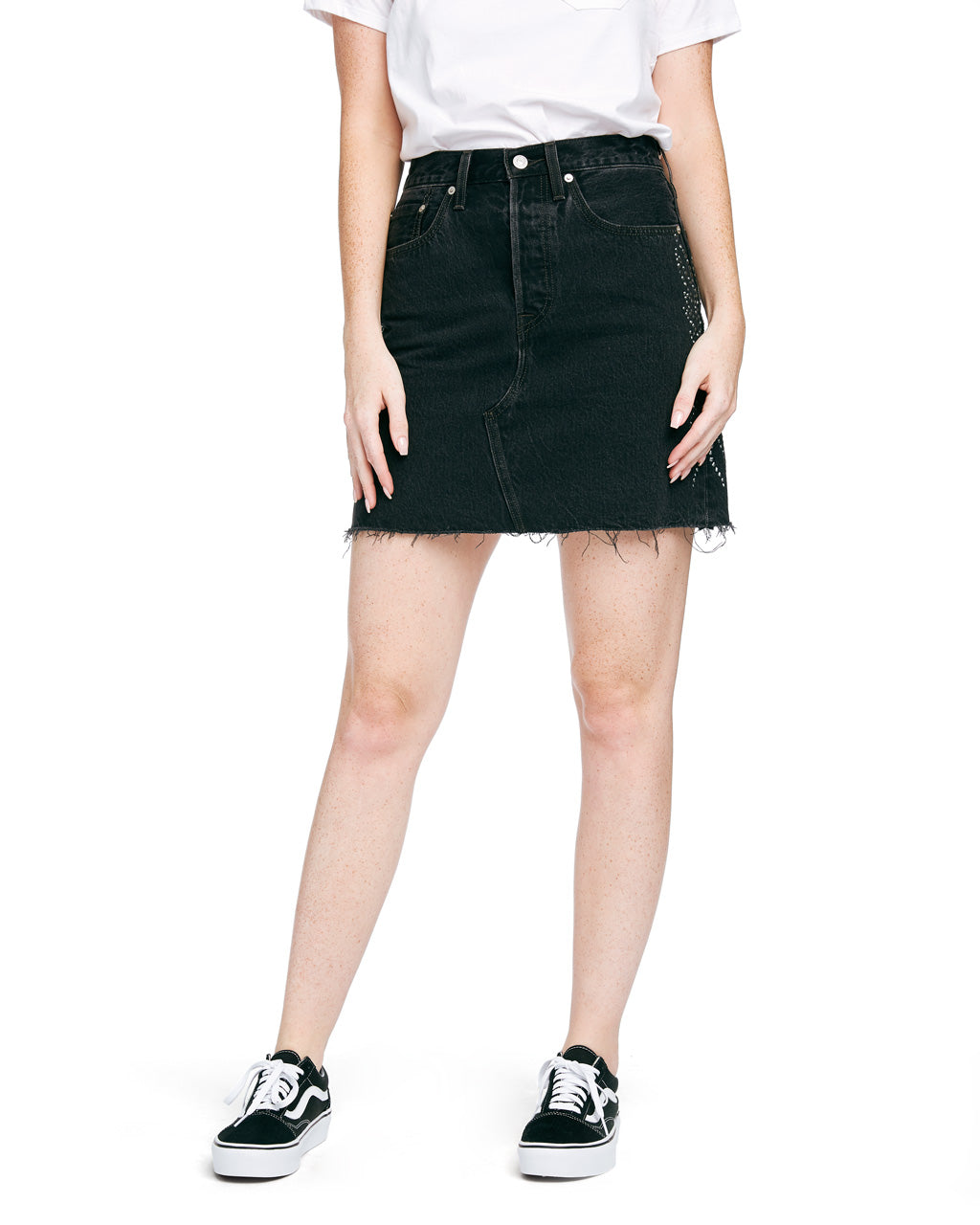 The HR Deconstructed Skirt by Levi's comes in faded black, with silver studded detail along the sides.