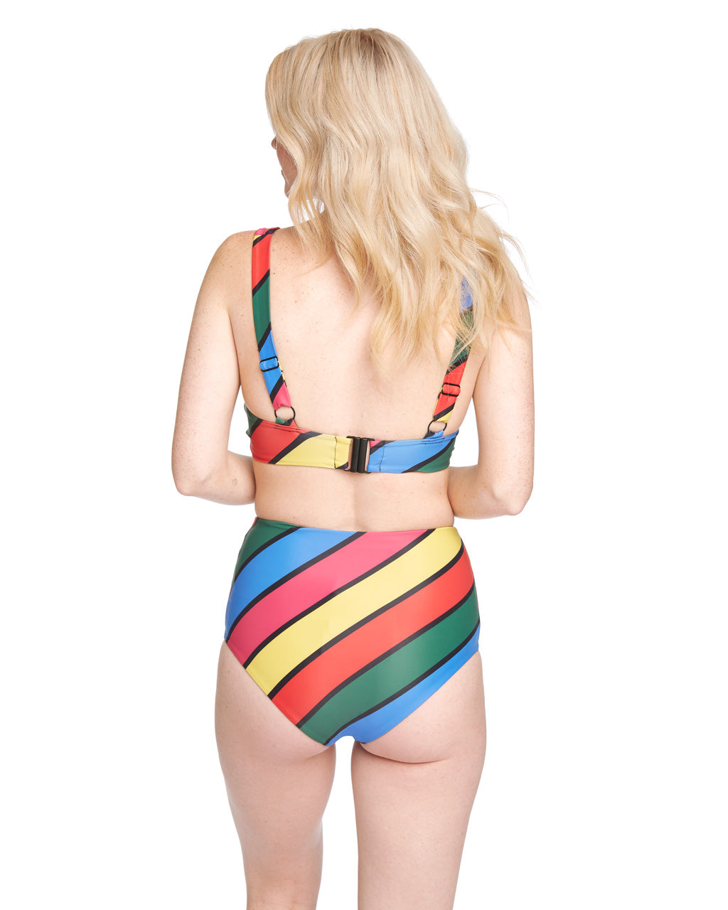 6e944bb0c9c ... Back shot of blonde woman in multi-colored striped wrap bikini top and  high- ...