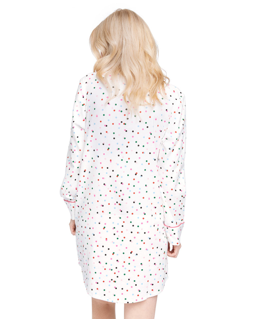 Back shot of a woman in a long sleeve button down pajama shirt with allover multi-color polka dot print.