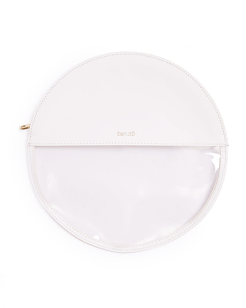 white circle clutch with see through plastic bottom half