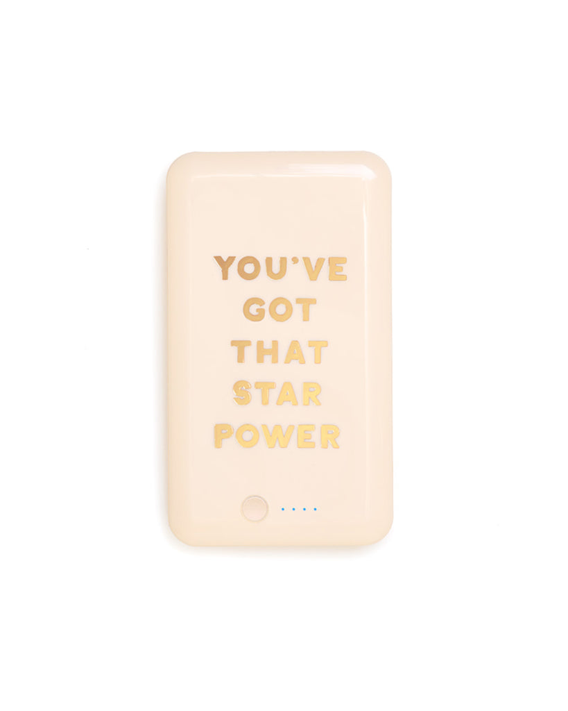 "light orange rectangular power bank with ""YOU'VE GOT THAT STAR POWER"" in uppercase gold letters"