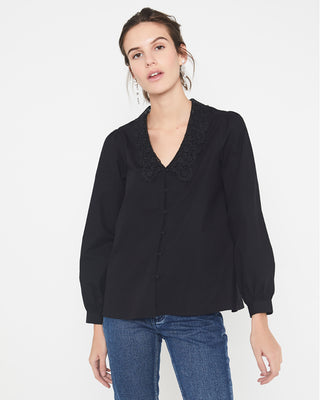 model wearing black long sleeved blouse