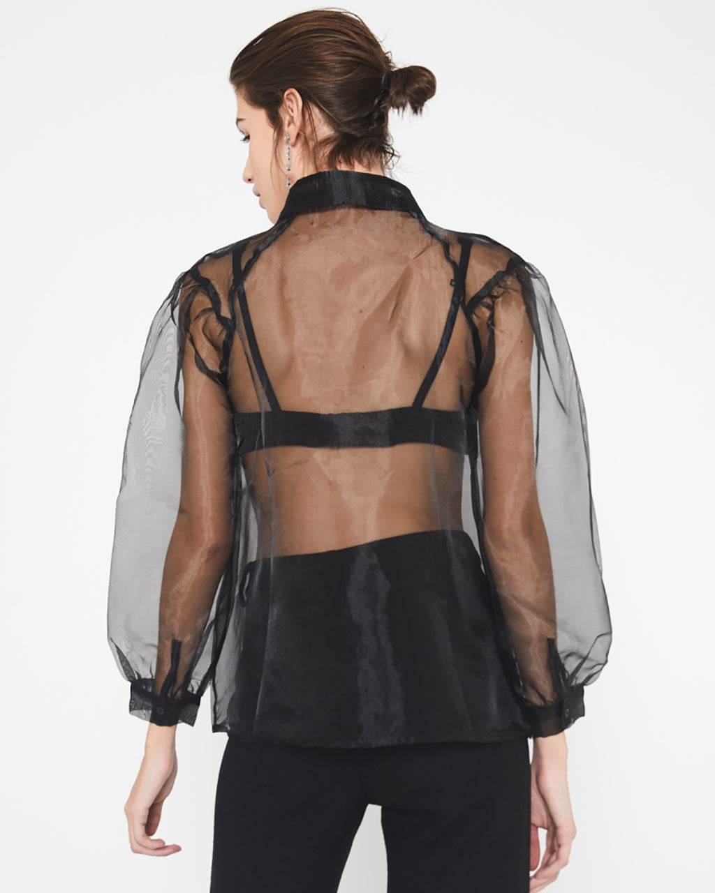 back view of model in transparent organza blouse