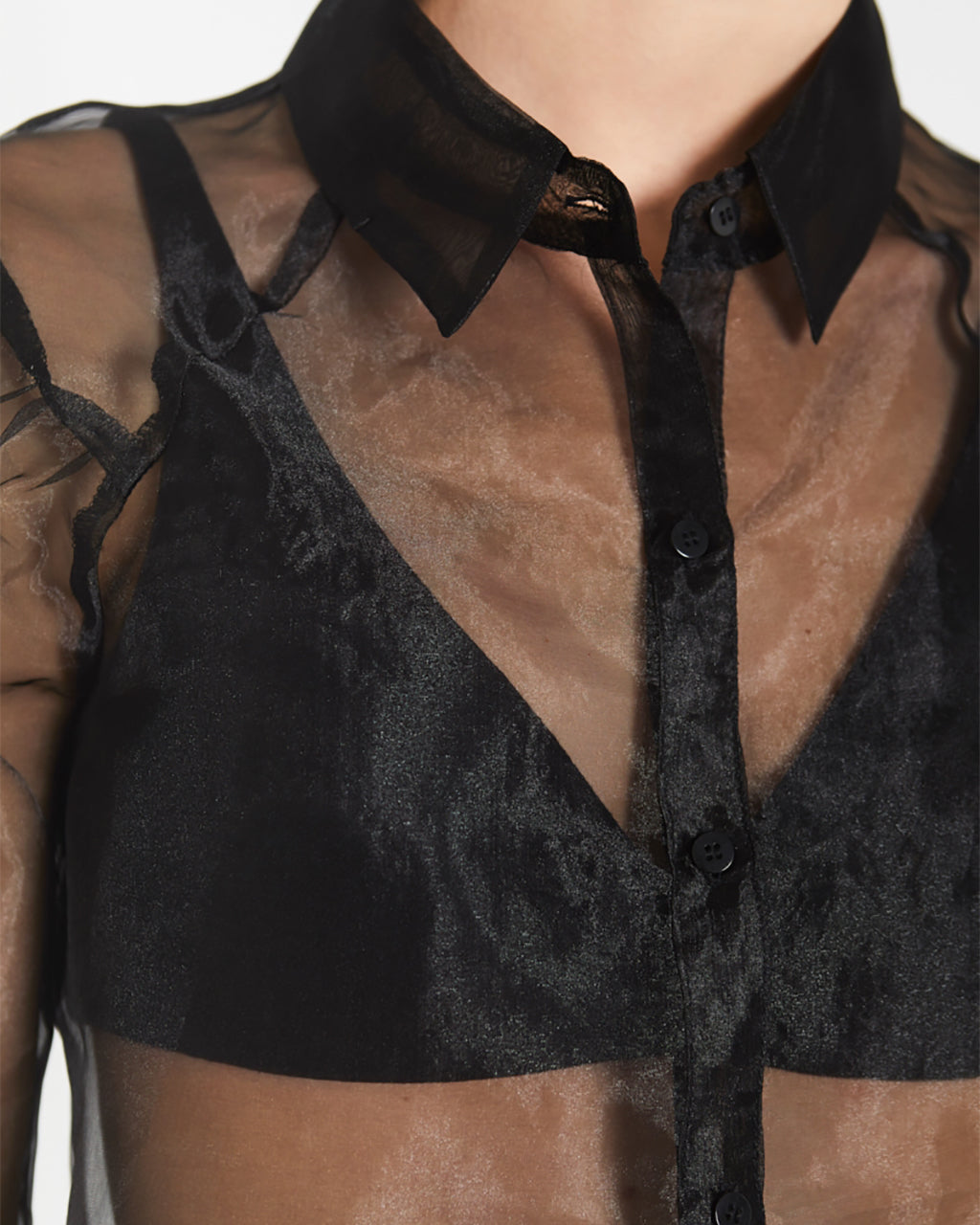 closeup of collar and chest in black transparent organza shirt