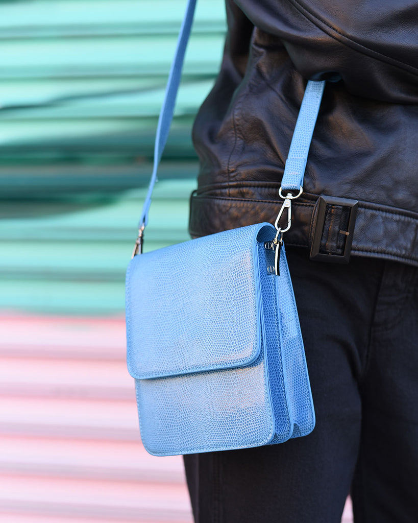 blue mini posh bag shown on model