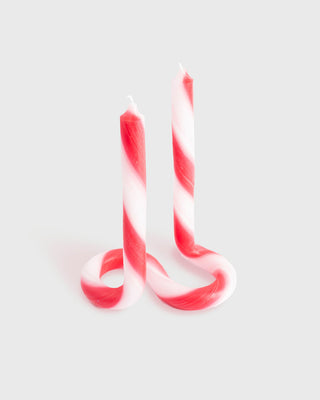 white and red stripe twist candle