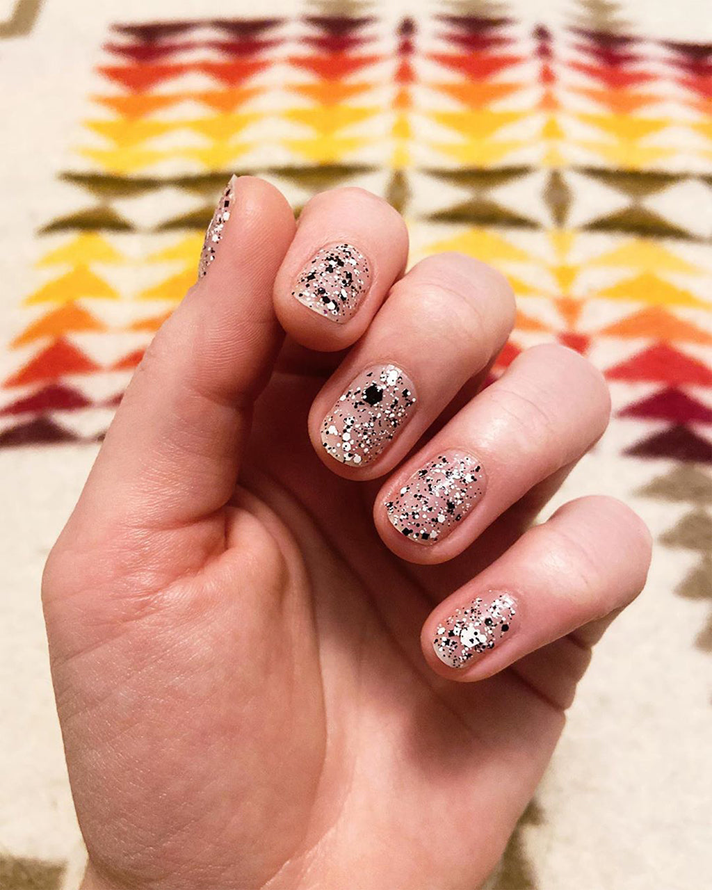 cookies and cream nail polish shown on model hands