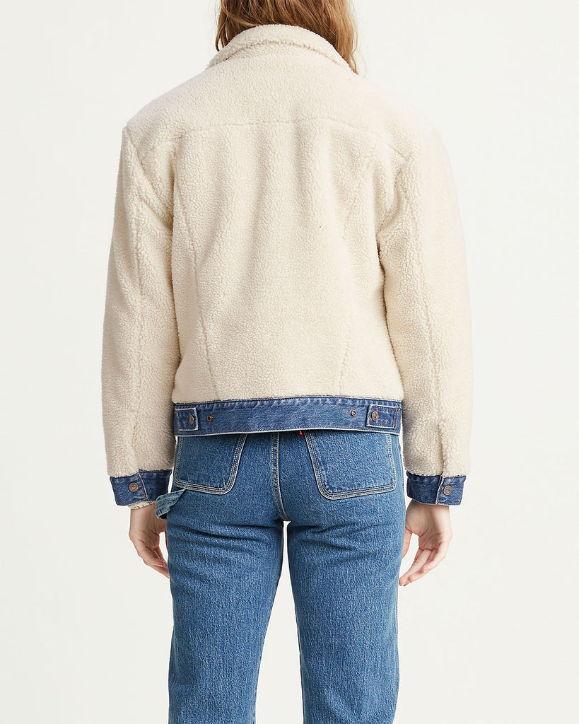 back view of model shown wearing sherpa jacket with denim trim