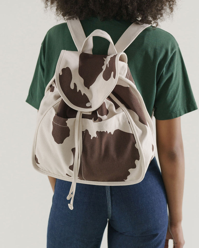 cow print backpack shown on model