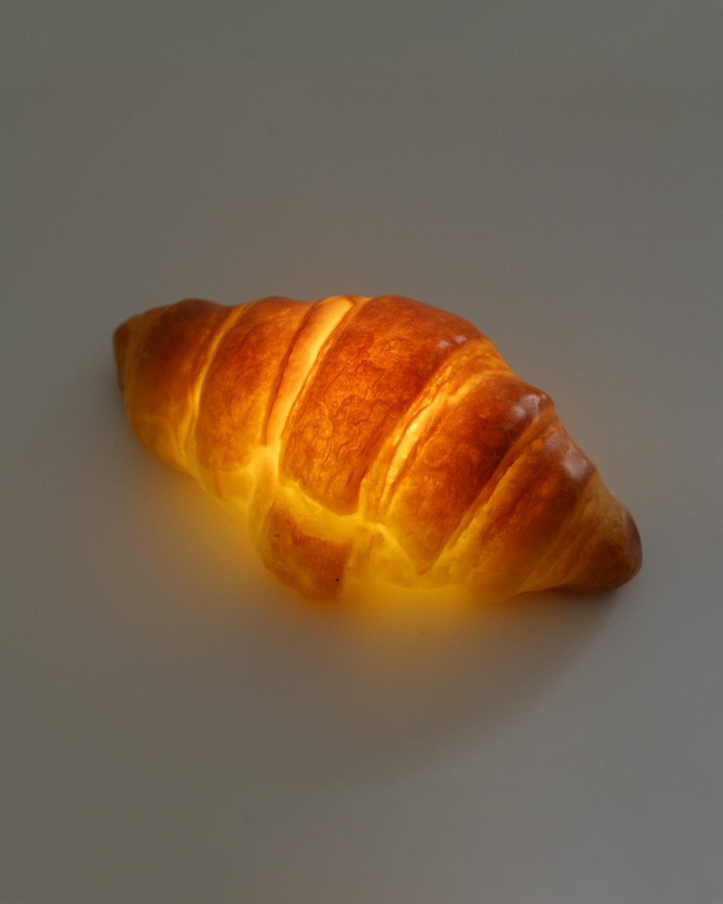 glowing lamp made from a real croissant