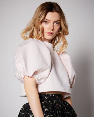 model shown wearing light pink puffed sleeve crop top