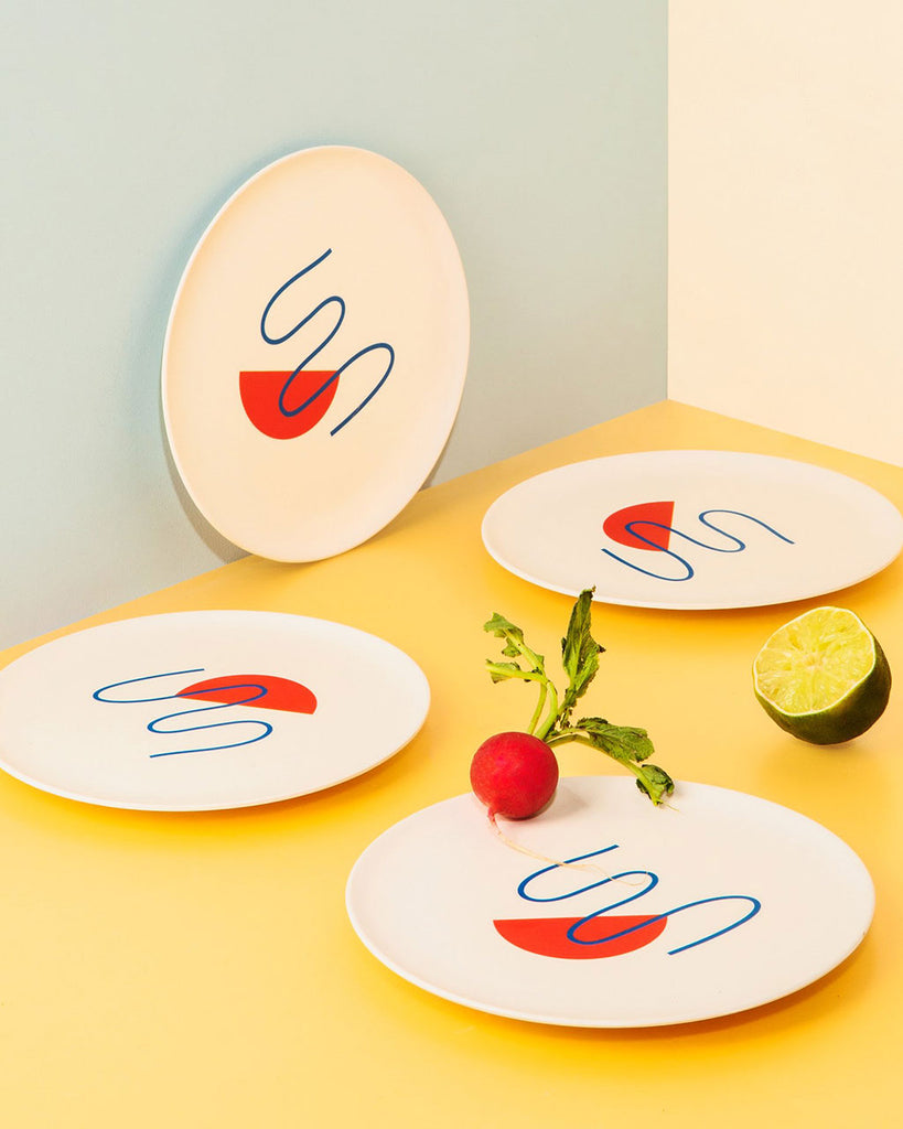 lifestyle shot of salad plates in doodle design