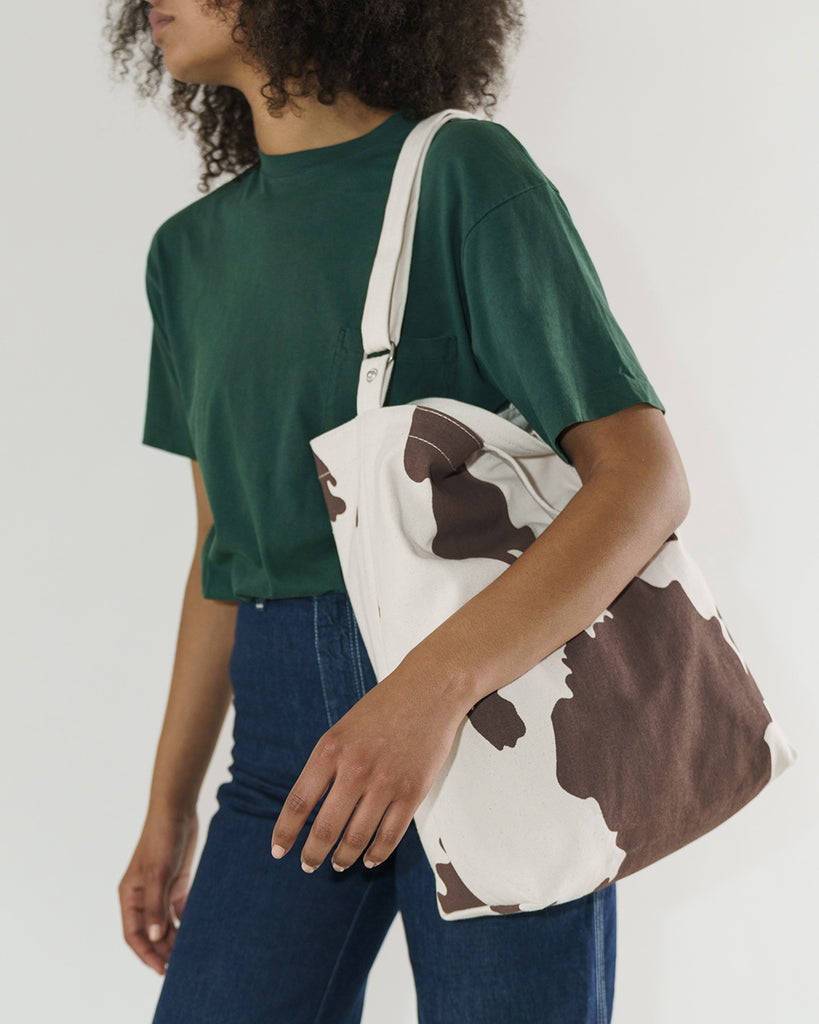 brown cow duck bag shown on model