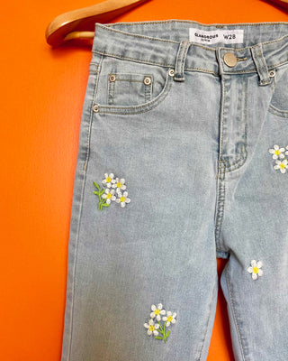 light wash jeans with embroidered white daisies