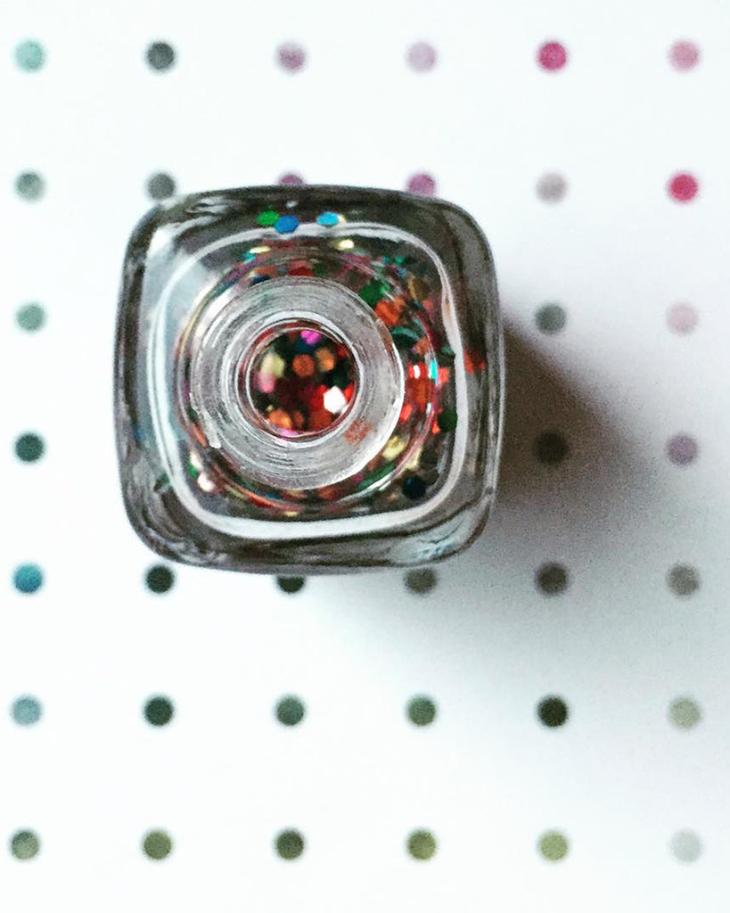 nail polish bottle of gumball shown open on a dot background