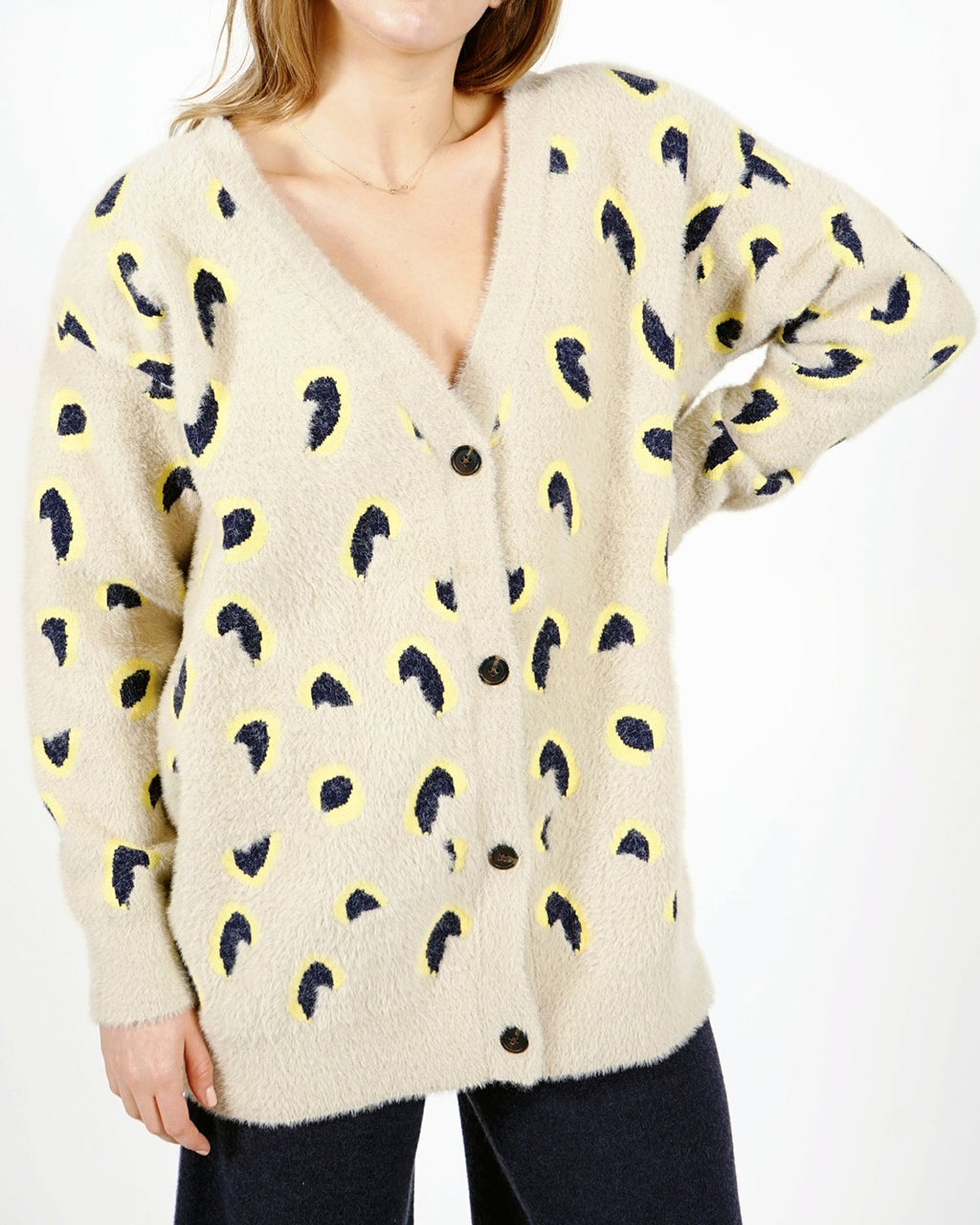 cream cardigan with a leopard like print design