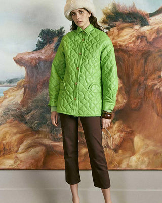 bright green quilted jacket shown on model with brown pants