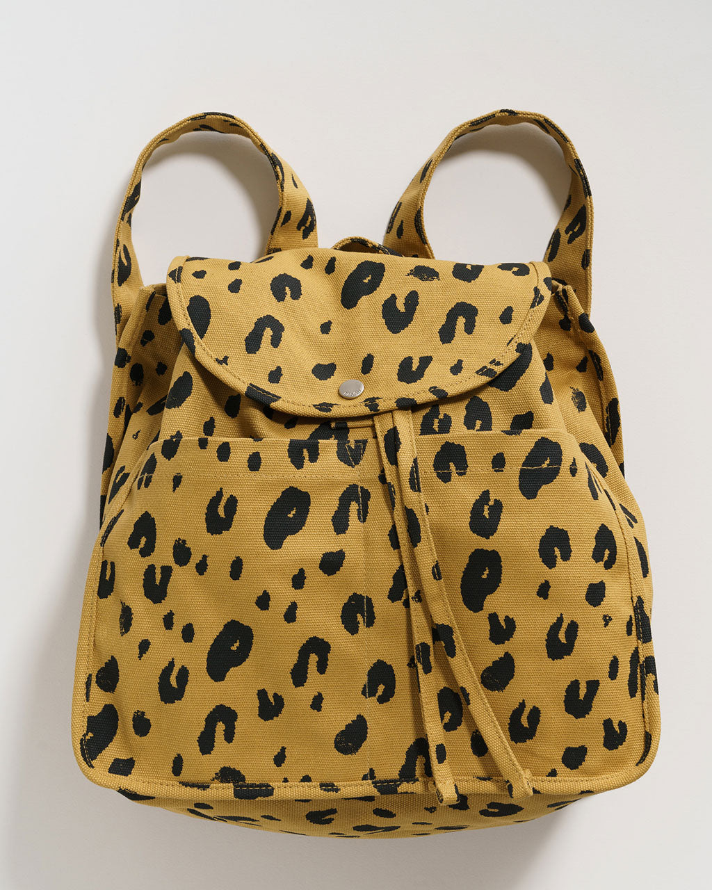 yellow canvas backpack with leopard print all over