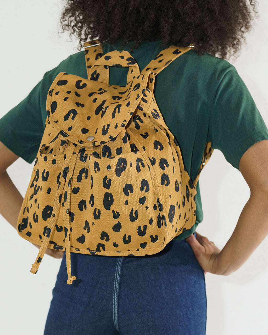 leopard print backpack shown on model