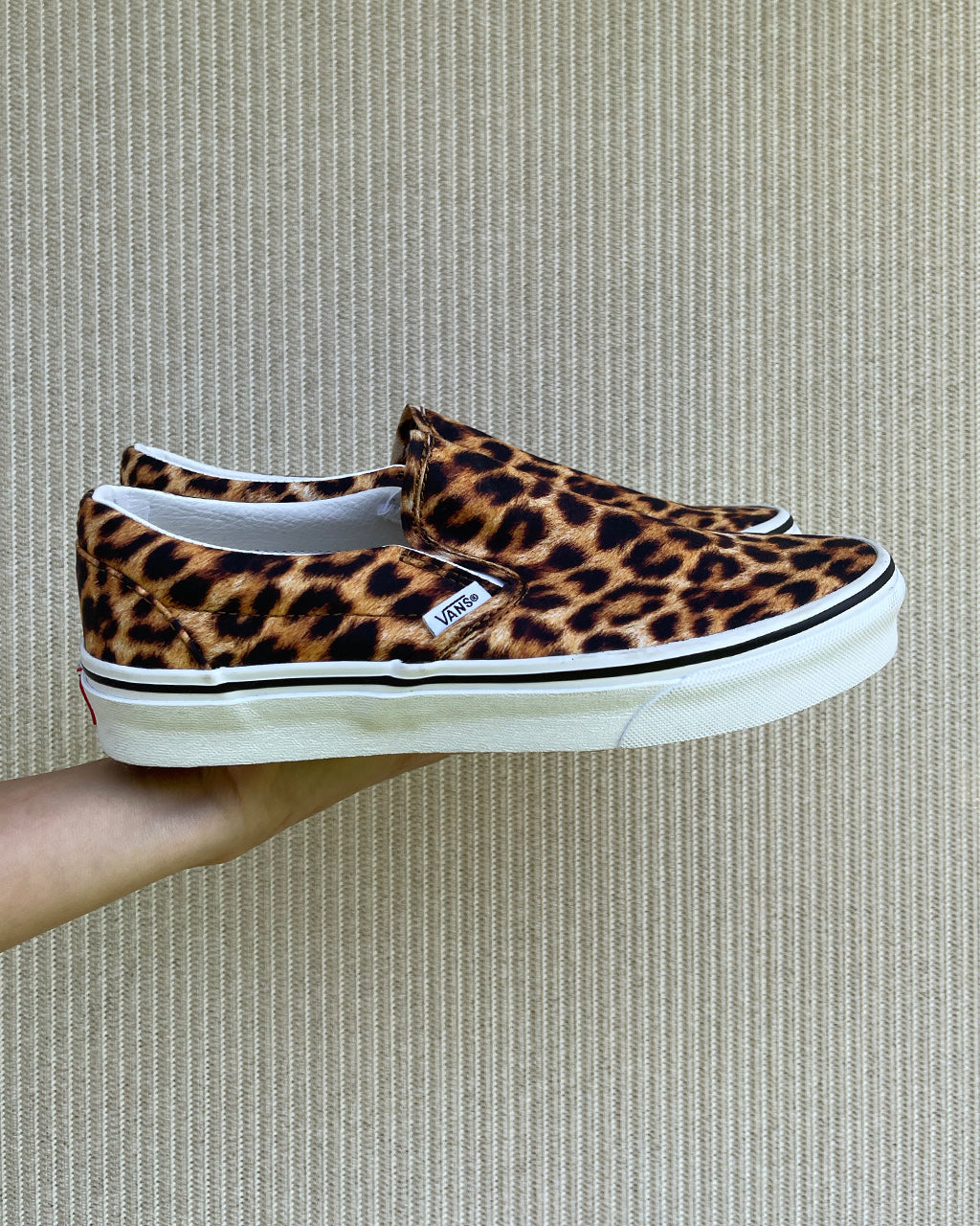 side view of classic slip on vans with a leopard print