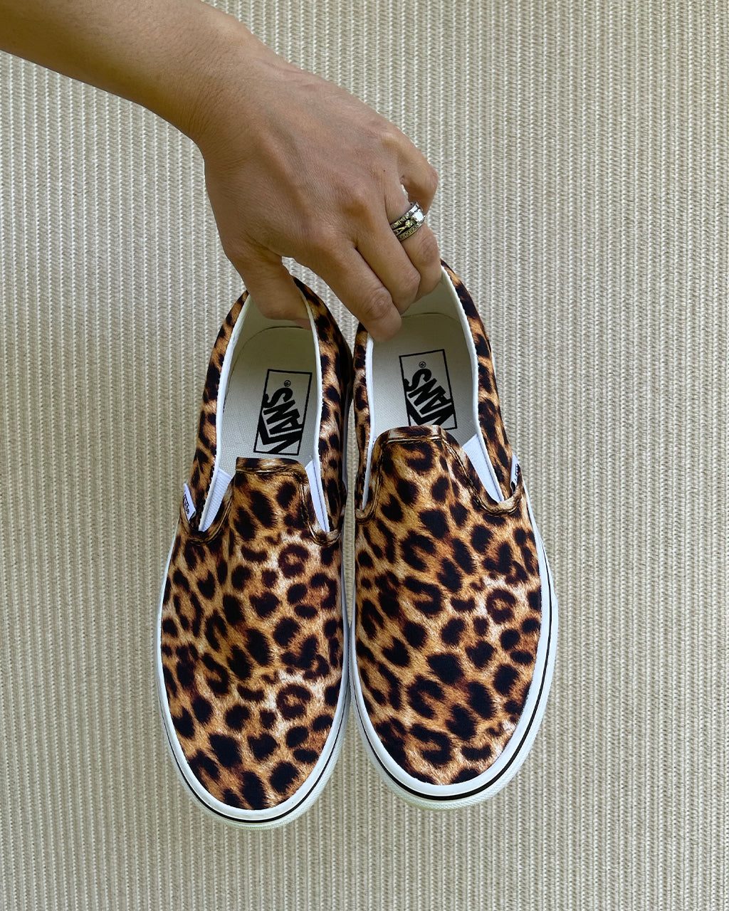 top view of leopard slip on classic vans