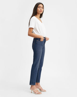 model shown wearing dark wash straight leg jeans with a white tee