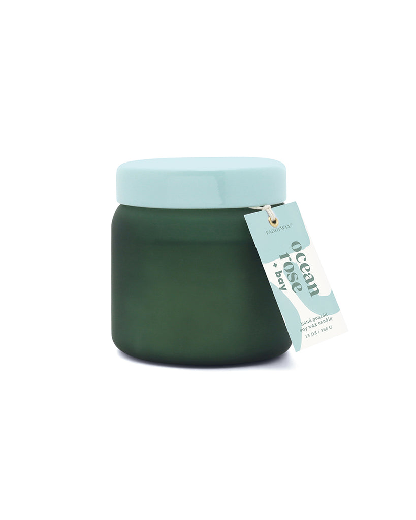 green vessel with blue lid candle