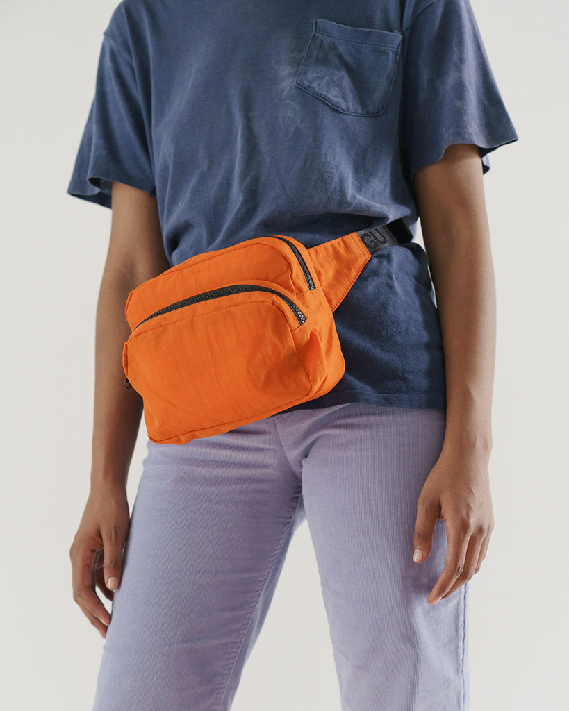 orange fanny pack shown on model