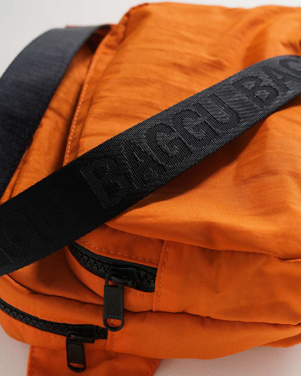 detailed image of orange fanny pack