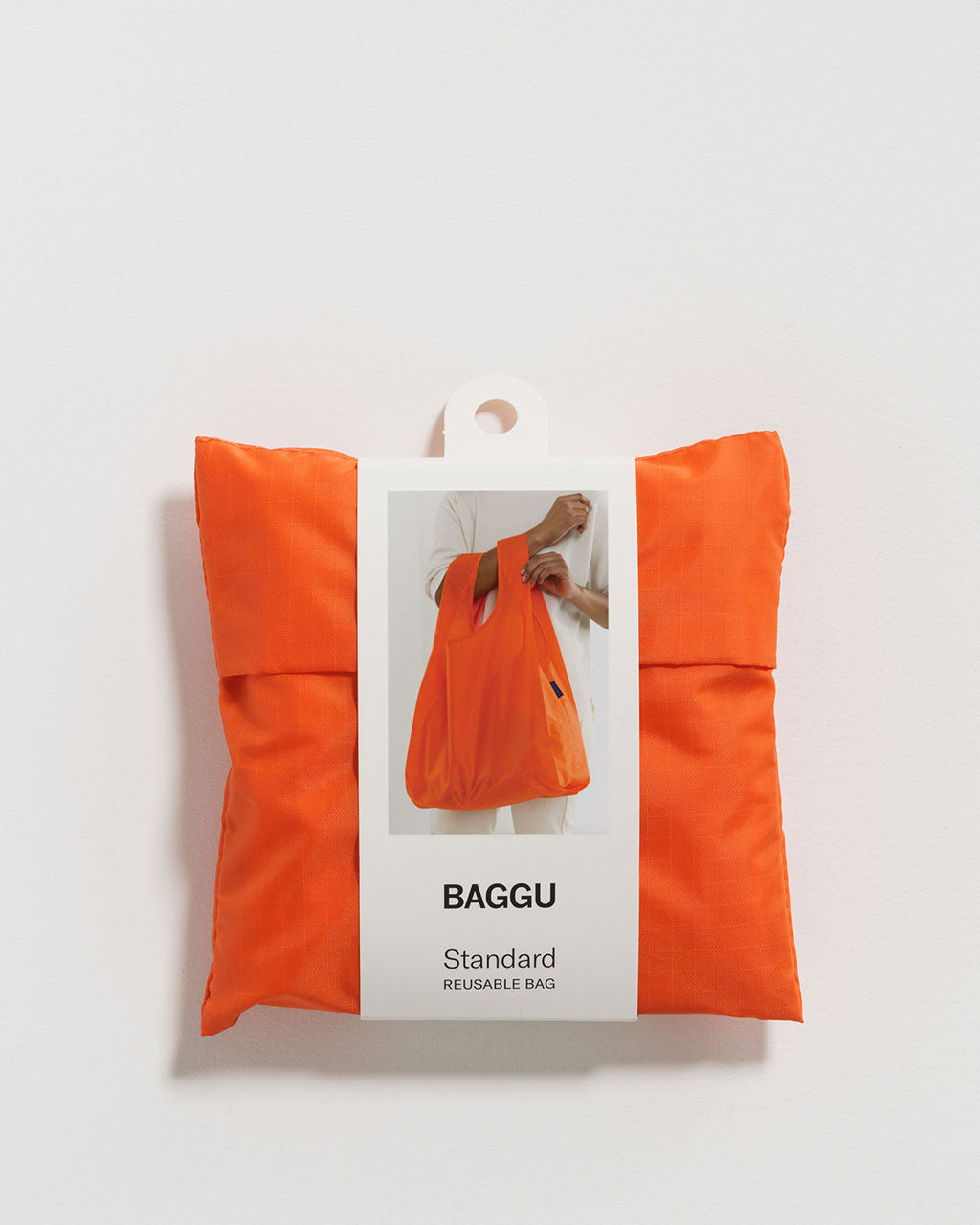 orange baggu shown in packaging