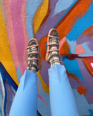 desert rose dolly sandals shown on model with black stripe socks