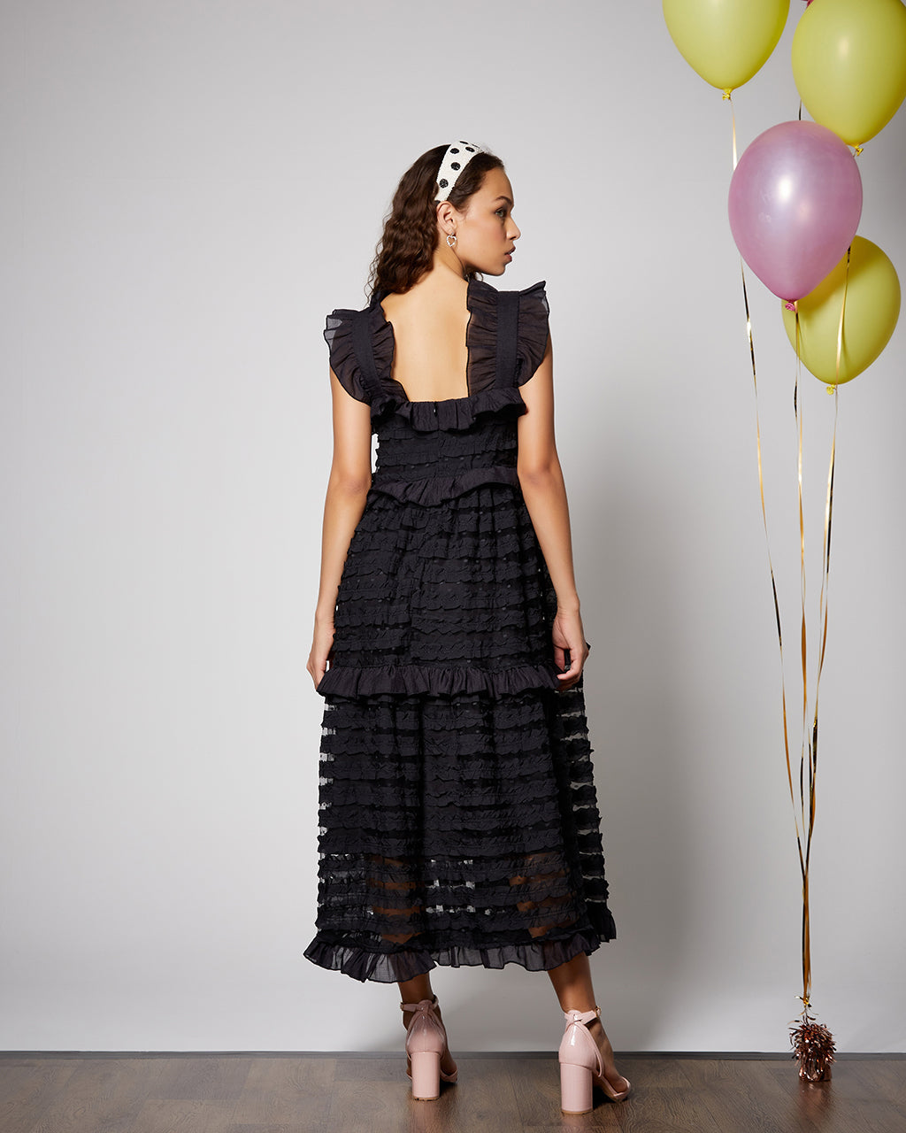 back view of black midi ruffle dress