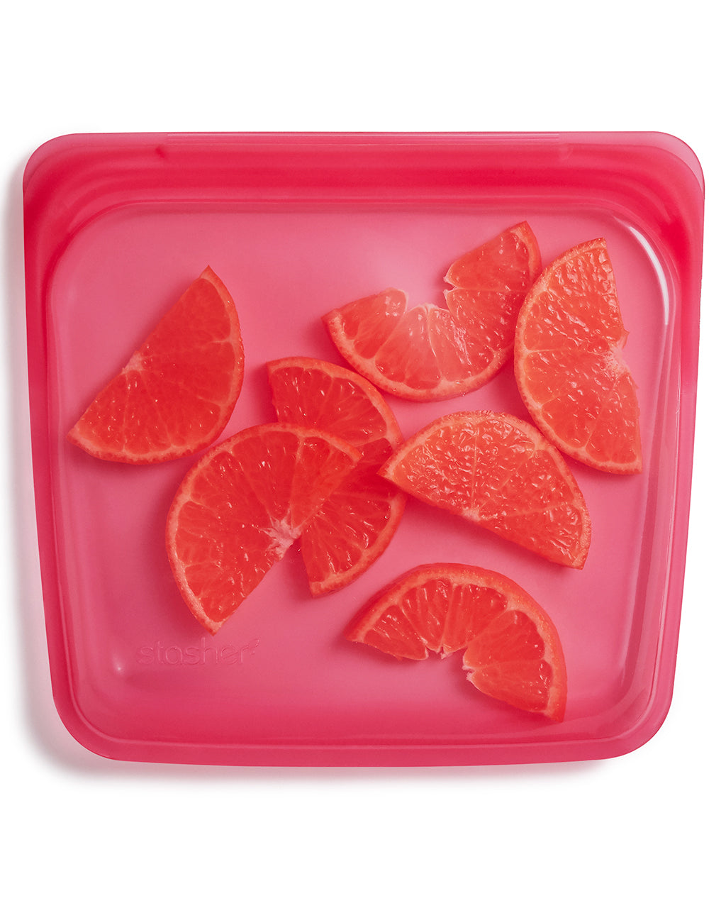 raspberry colored sandwich storage shown with oranges
