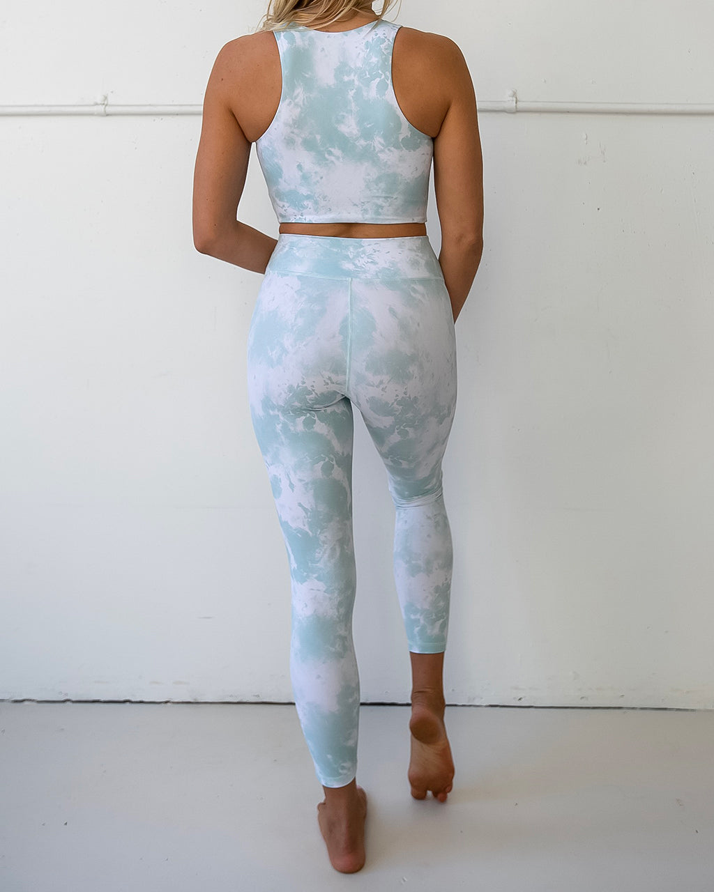 back view of seafoam tie dye leggings