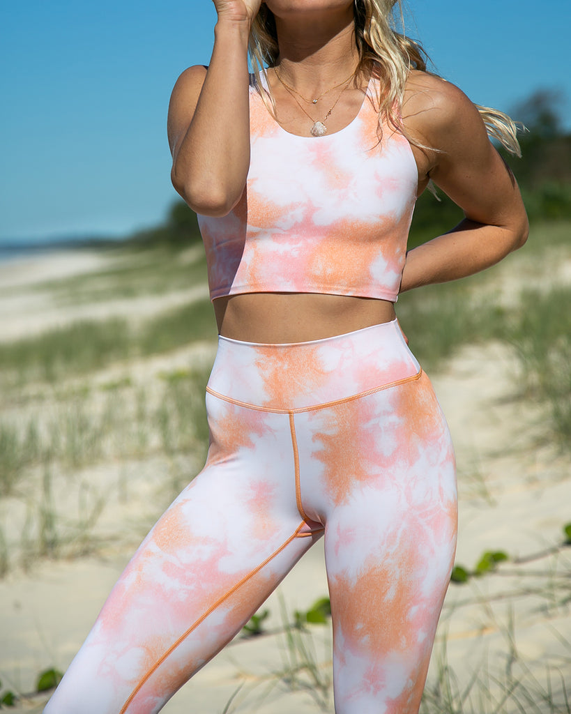 sherbet tie dye leggings shown on model