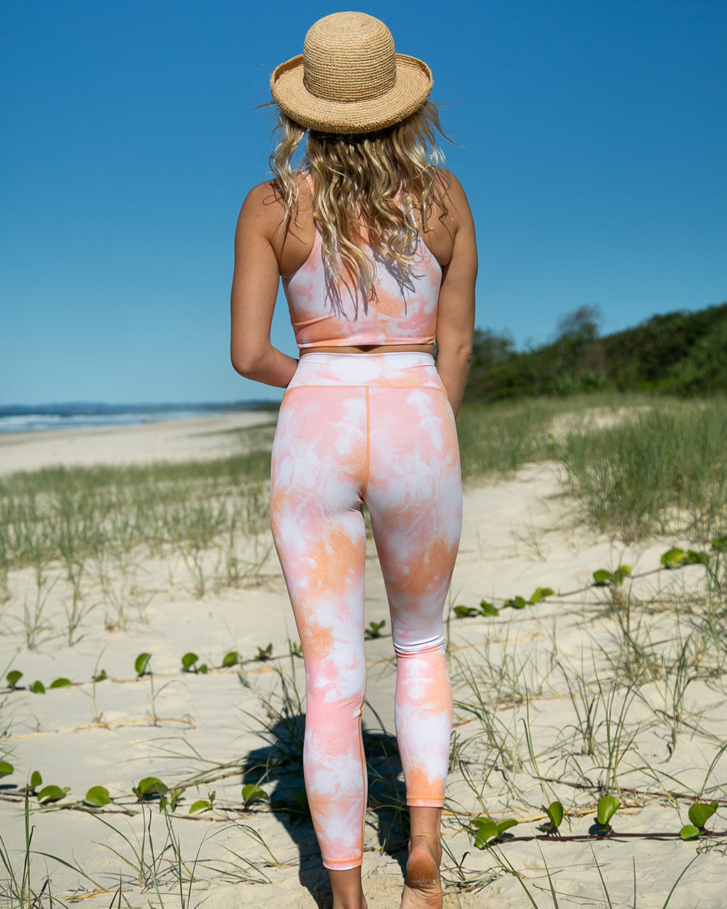 model shown wearing sherbet tie dye leggings
