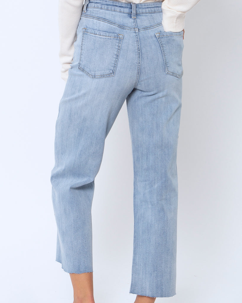 back view of faded indigo jeans